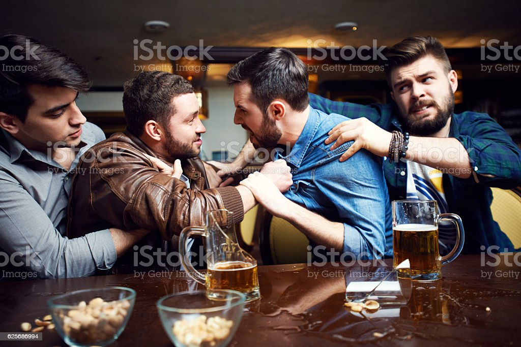 Drunken men fighting in pub stock photo