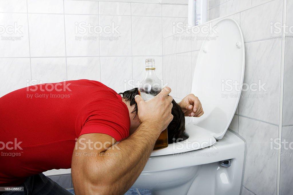 drunken young man in bathroom stock photo
