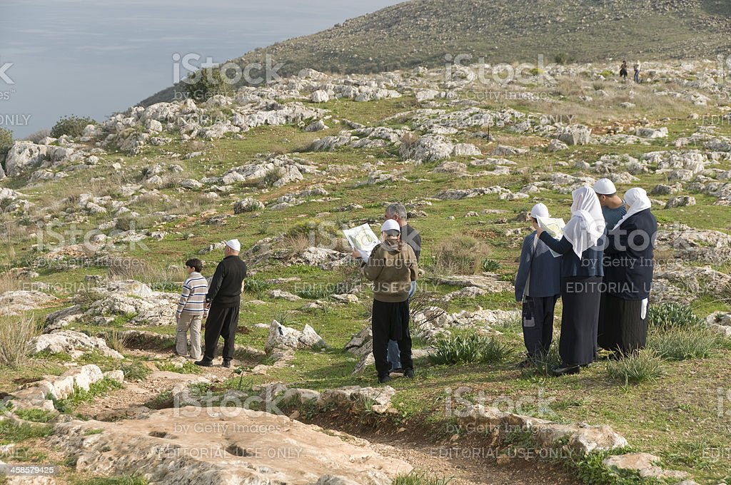 Druze family visiting the Mount Arbel near Sea of Galilee stock photo