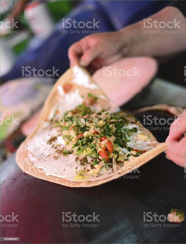 Druze taboon pita bread with salad in Carmel Market stock photo