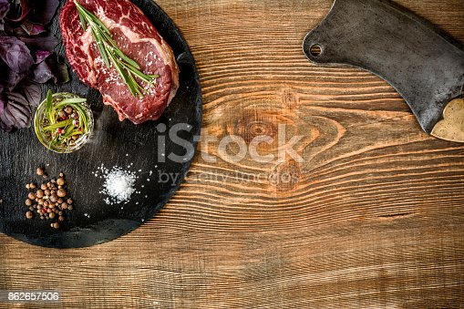 istock Dry aged raw beef steak with ingredients for grilling 862657506