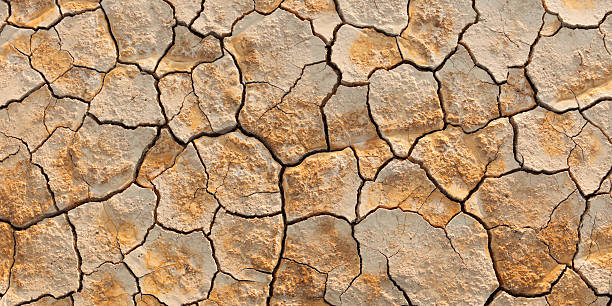 Dry and cracked earth stock photo