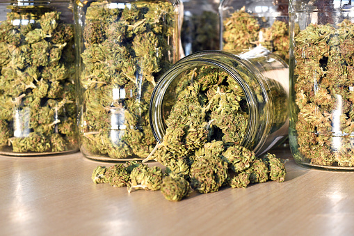 Dry And Trimmed Cannabis Buds Stored In A Glass Jars Stock Photo - Download Image Now