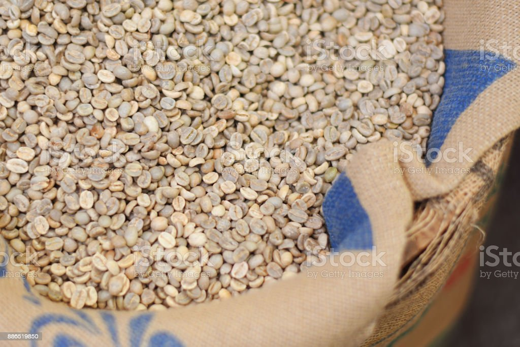 Dry arabica coffee beans in the bag. stock photo