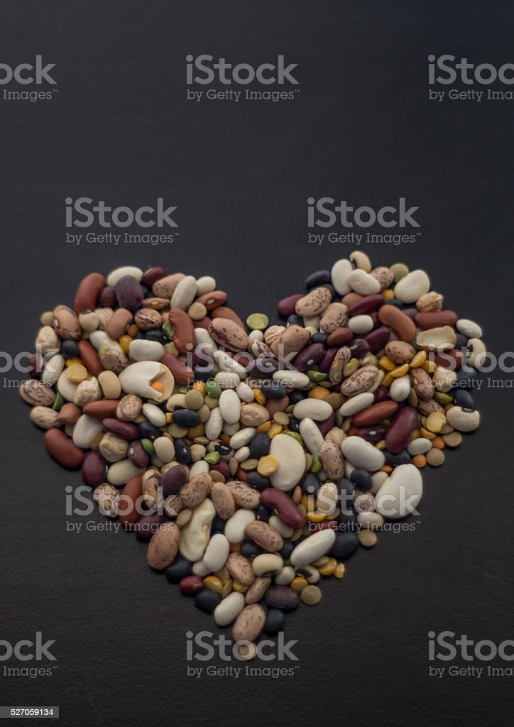 Dry beans in heart shape pile royalty-free stock photo