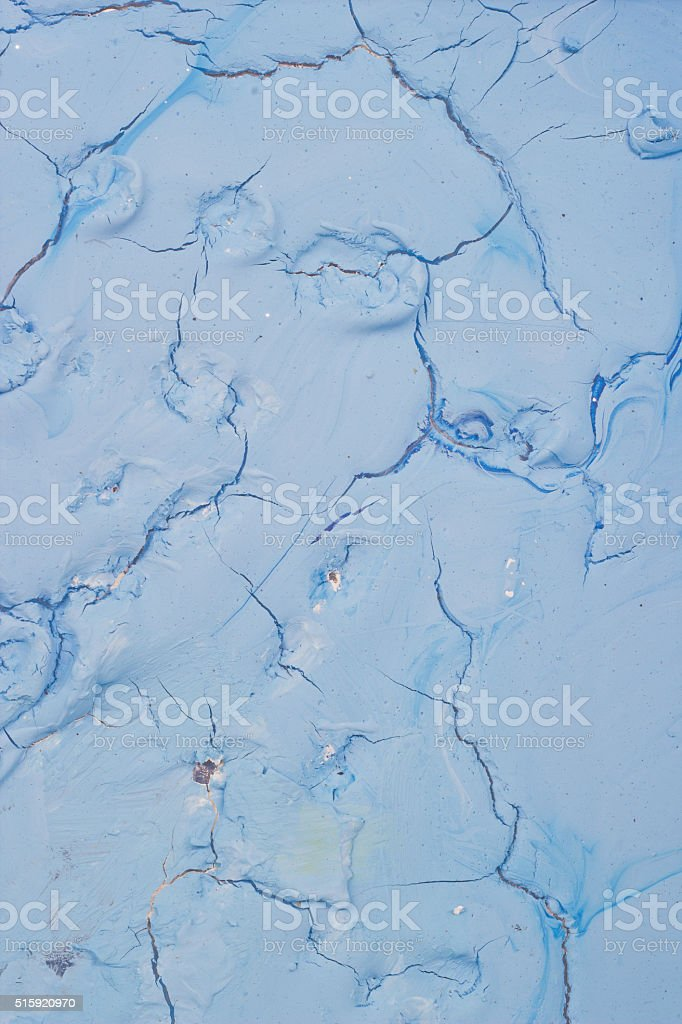 Dry blue oil paint cracks and crevices texture for background stock photo