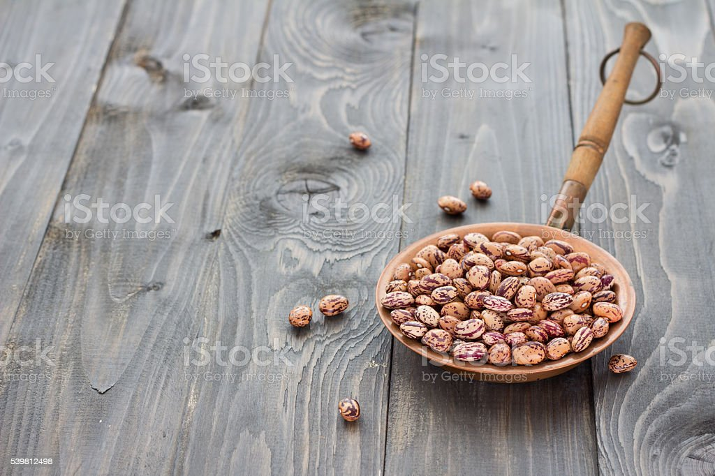 Dry borlotti beans in a copper bowl stock photo