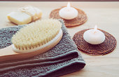 istock Dry brushing the skin in a pattern with a dry brush, usually before showering help reduce cellulite and remove toxins in human body. Selective focus natural brush, Instagram filter style. 1142844664