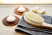istock Dry brushing the skin in a pattern with a dry brush, usually before showering help reduce cellulite and remove toxins in human body. Selective focus on firm, natural bristle brush with a long handle. 1142844665