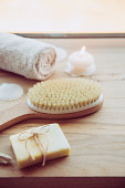 istock Dry brushing the skin in a pattern with a dry brush, usually before showering help reduce cellulite and remove toxins in human body. Selective focus on firm, natural bristle brush with a long handle. 1142844672