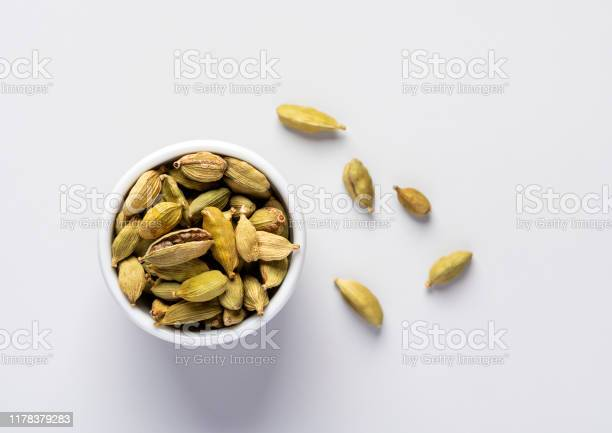 Dry Cardamom Pots In A White Bowl Stock Photo - Download Image Now