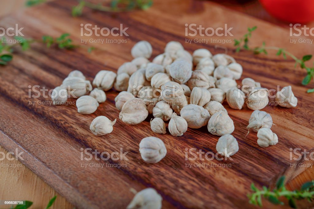 dry cardamon seed on wooden board stock photo