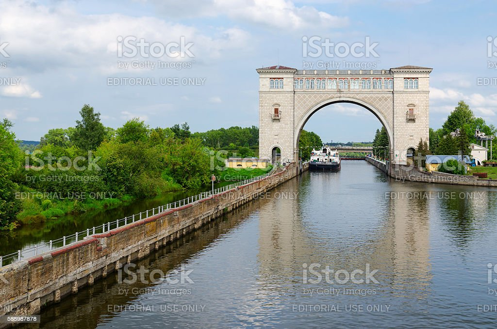 Dry cargo ship in navigation lock of Uglich hydroelectric power stock photo