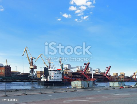 Dry cargo vessel and bunkers at Marina in Ventspils in Latvia. Ventspils a city in the Courland region of Latvia. Latvia is one of the Baltic countries