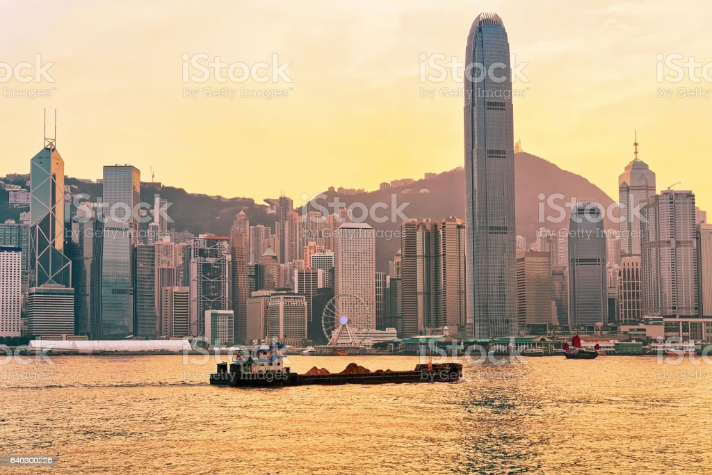Dry cargo vessel and Victoria Harbor of Hong Kong sunset stock photo
