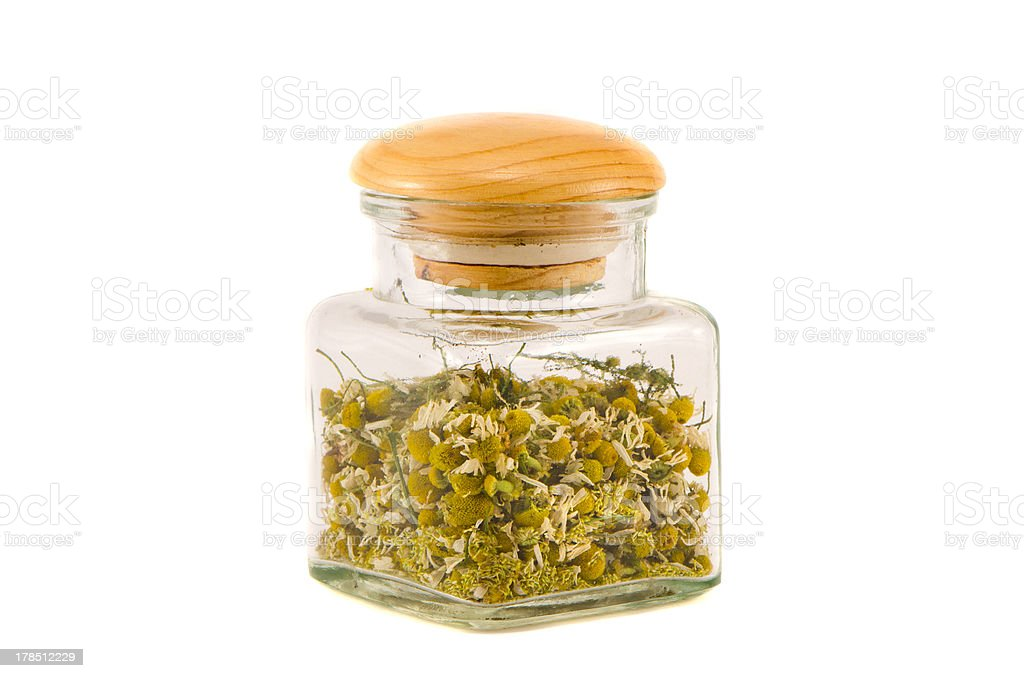 dry chamomile flower medical blossoms in glass jar royalty-free stock photo