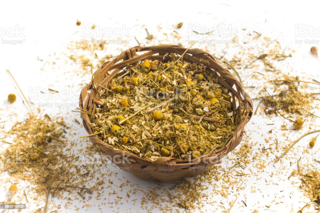 Dry chamomile into a basket royalty-free stock photo