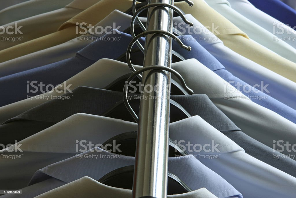 Dry Cleaned Men's Shirts on Hangers on a Rack royalty-free stock photo