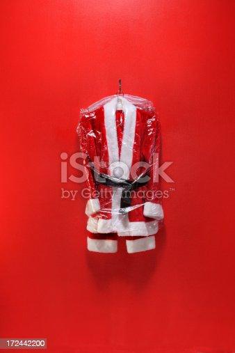 Dry cleaned santa suit in plastic bag