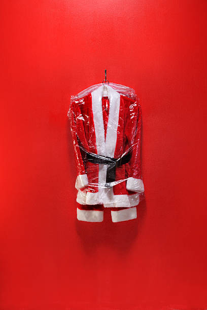 Dry Cleaned Santa Suit Dry cleaned santa suit in plastic bag coat garment stock pictures, royalty-free photos & images