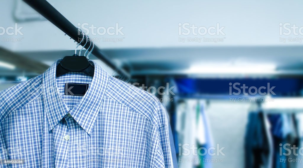 Dry cleaning things hanging in a row stock photo
