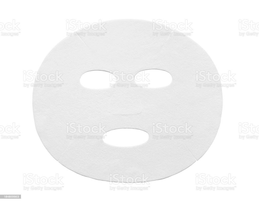 Dry cotton facial mask sheet on white background stock photo