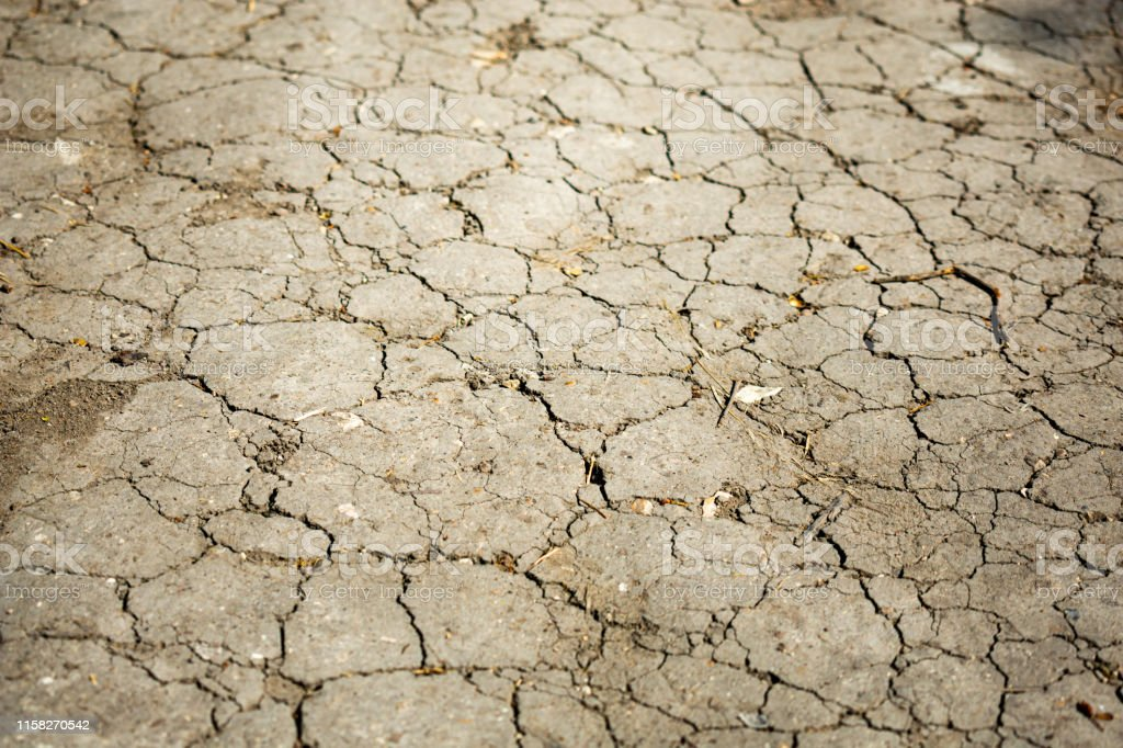 Dry cracked earth. Negative effects of human activity on the...