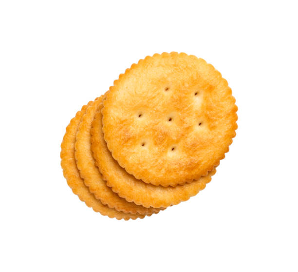 Dry cracker cookies isolated on white background cutout, top view, concept of food stock photo