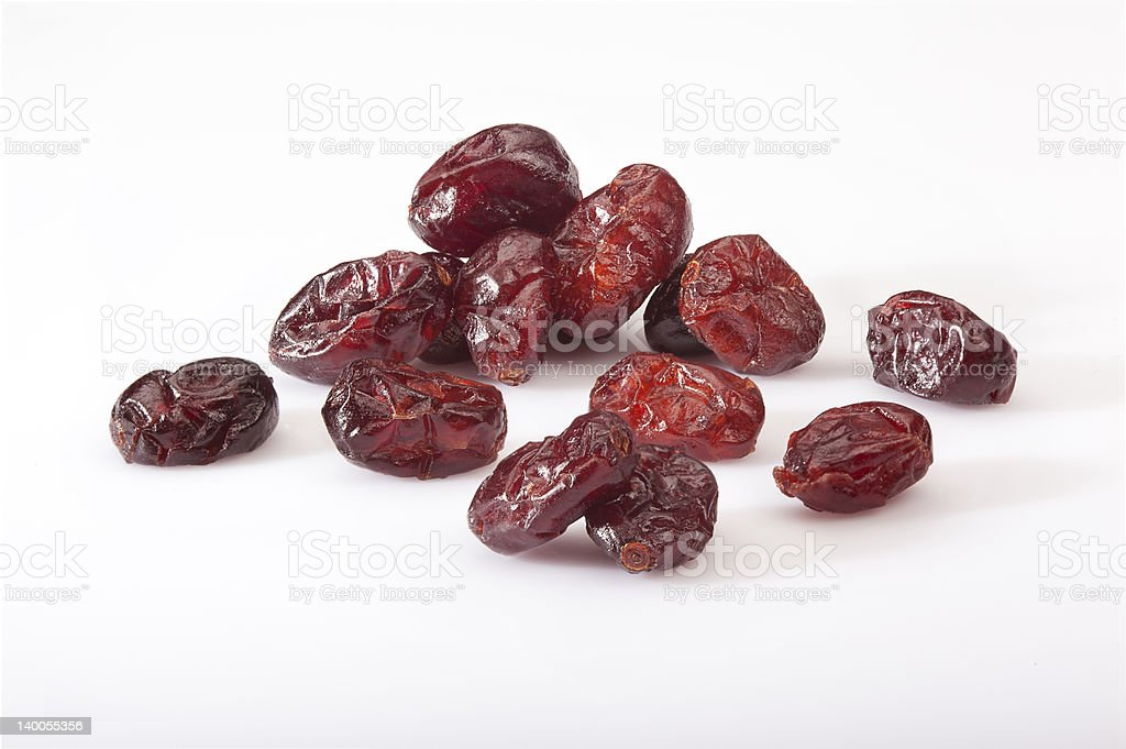 Dry cranberries pile on white background stock photo