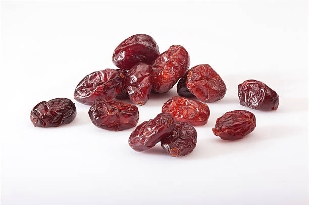 dry cranberries pile on white background - dry stock pictures, royalty-free photos & images