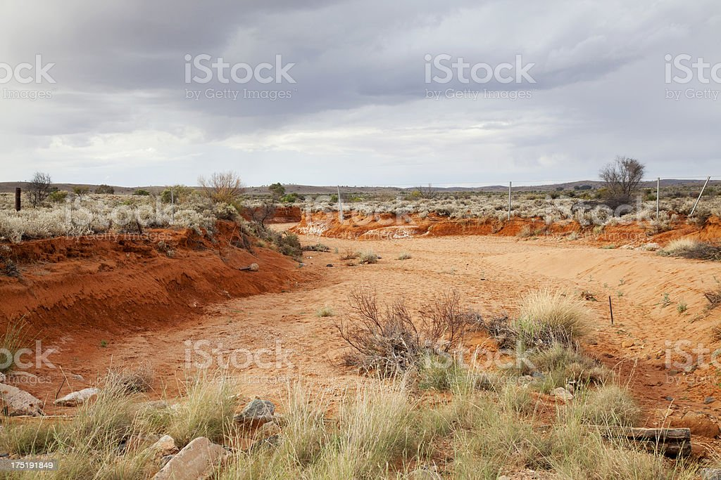 Dry creek bed in outback Australia, with storm approaching stock photo