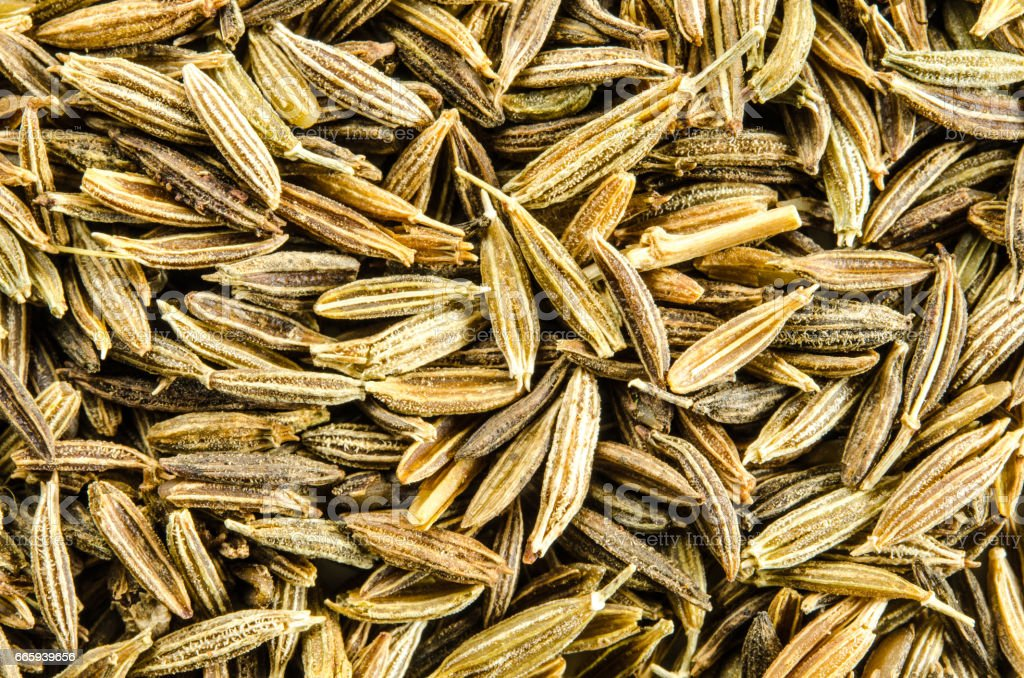 Dry cumin seeds background. foto stock royalty-free
