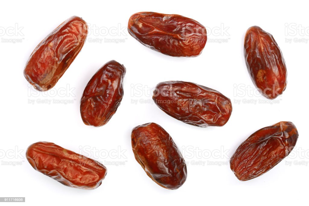 dry dates isolated on white background. Top view. Flat lay pattern stock photo