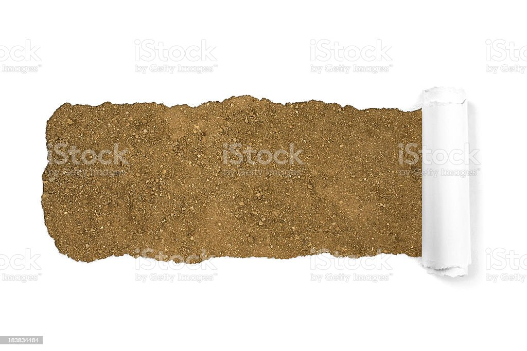 Dry dirt through white torn paper royalty-free stock photo