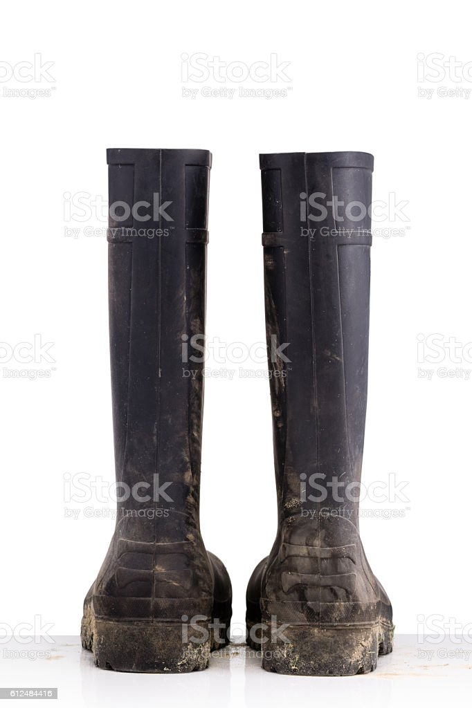Dry dirty Mud boots isolated on white background back view stock photo