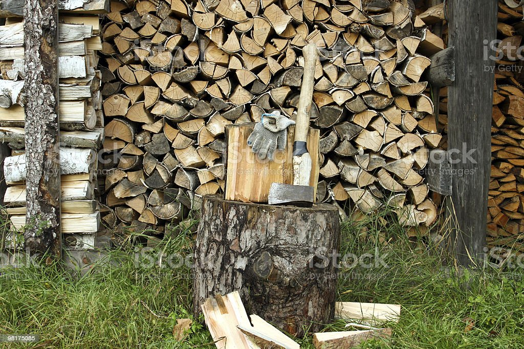 dry fire wood stored by numbers for storage royalty-free stock photo