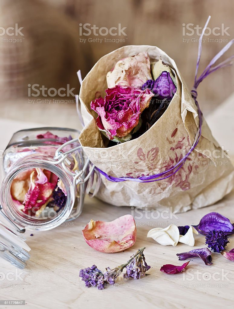 Dry flowers and leaves in paper bag