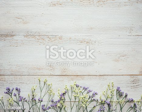 Dry flowers on white wooden planks. View from above. Flat lay. Copy space.