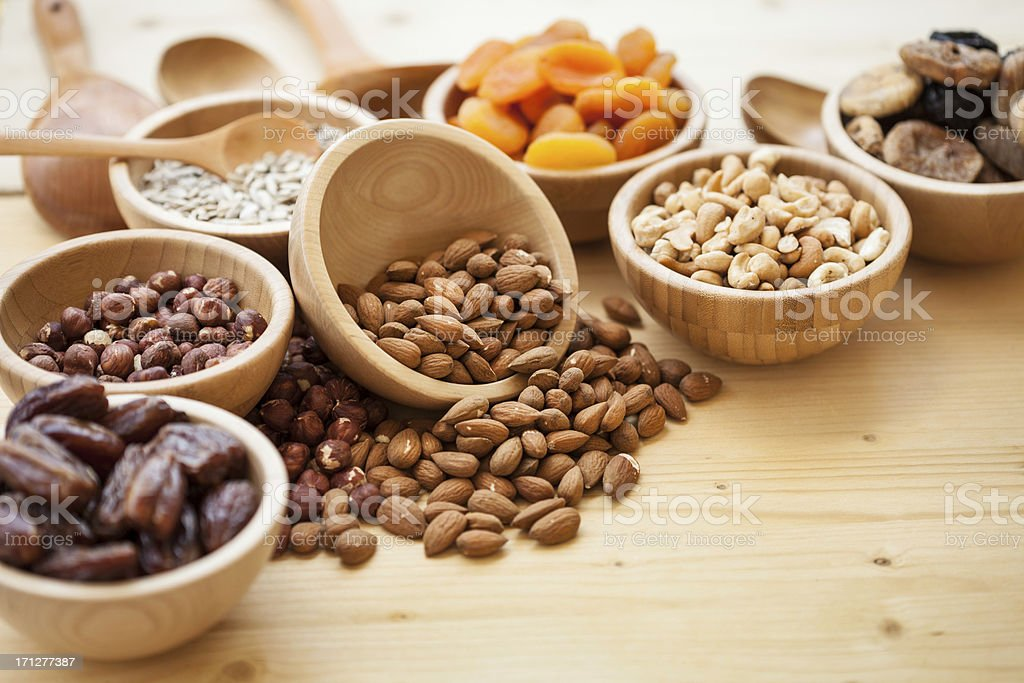 Dry fruits and nuts at wooden table stock photo