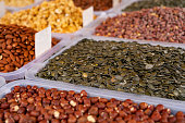 Dry fruits and nuts sold at a market.