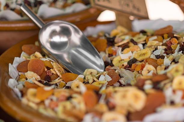 dry fruits like banana, apricot, raisin - trail mix stock photo