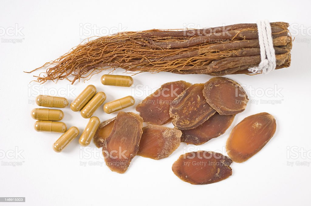 Dry Ginseng Slices, capsules and roots royalty-free stock photo