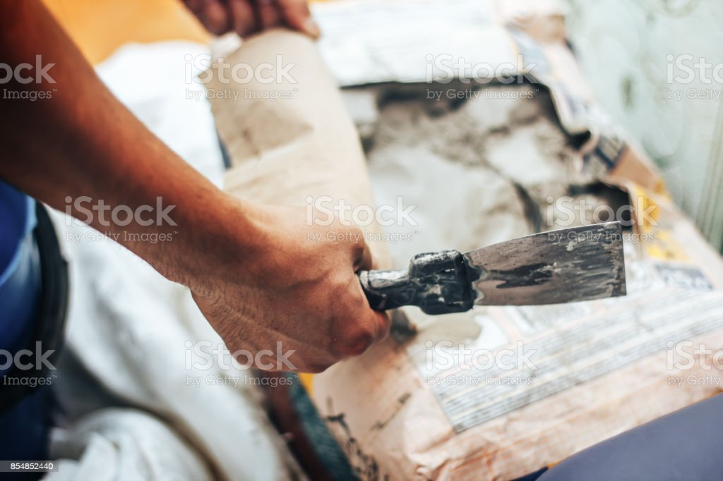 dry glue for a tile in bag stock photo