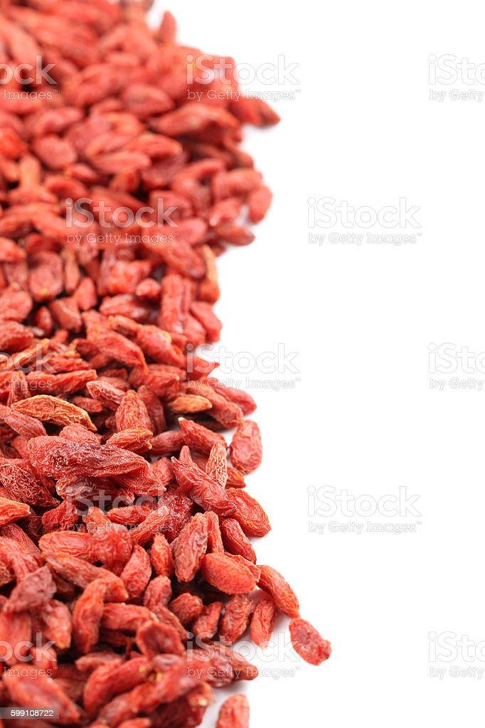 Dry goji berries isolated on a white stock photo