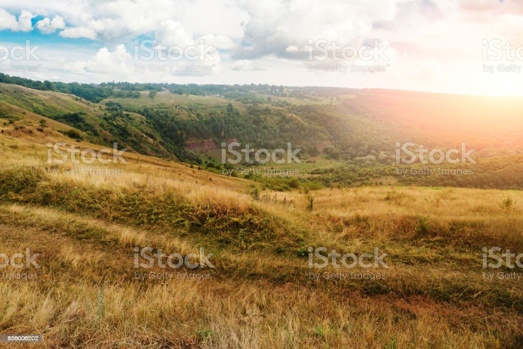 dry grass on the mountain with blue sky at doi monjong, stock photo