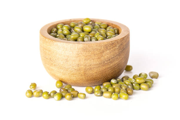 Dry green mung beans isolated on white stock photo