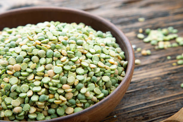 dry green peas on a clay plate on the table. stock photo