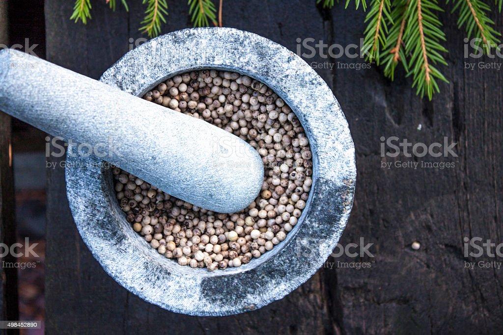 Dry green pepper mortar stock photo