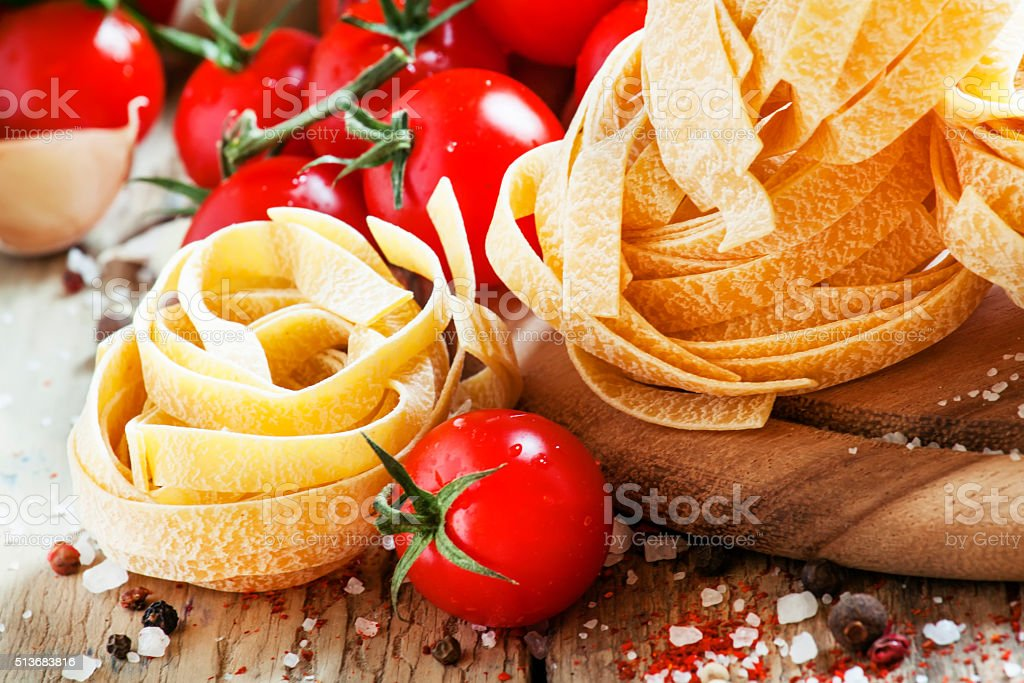 Dry Italian pasta fettuccine in the form of nests stock photo