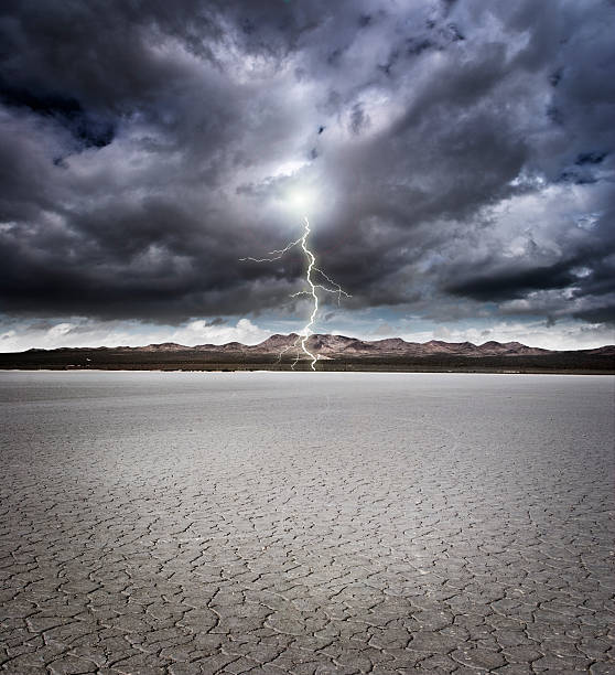 Dry lake bed Dry lake bed with storm clouds and lightning lake bed stock pictures, royalty-free photos & images